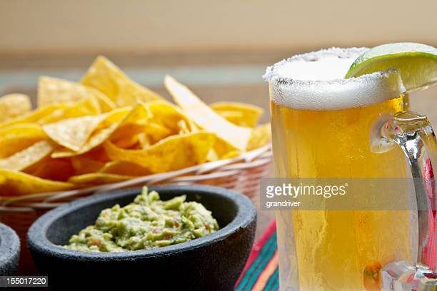 chips, beer and guacamole - mexican beer stock pictures, royalty-free photos & images