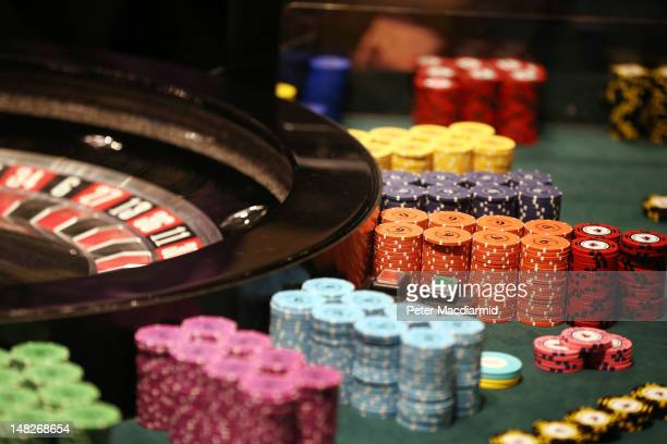 Chips pile up next to a roulette wheel at The Hippodrome Casino near Leicester Square on July 13 2012 in London England The new casino has five...