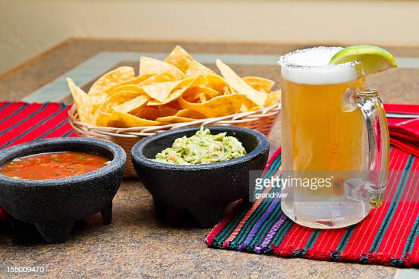 chips, salsa, beer and guacamole - mexican beer stock pictures, royalty-free photos & images