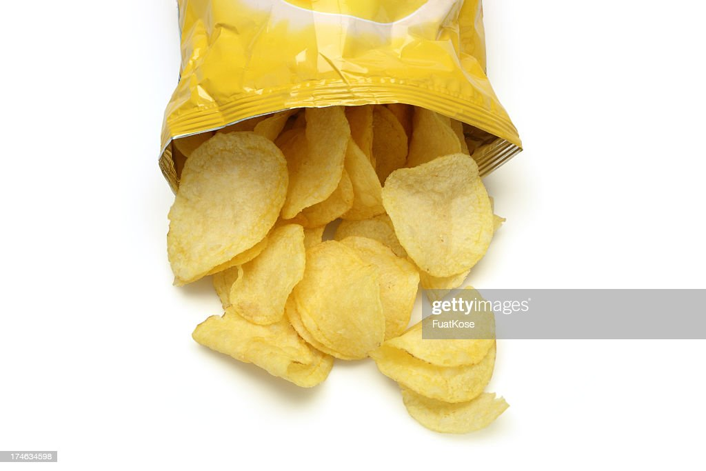 Chips spilling out of an open bag : Stock Photo