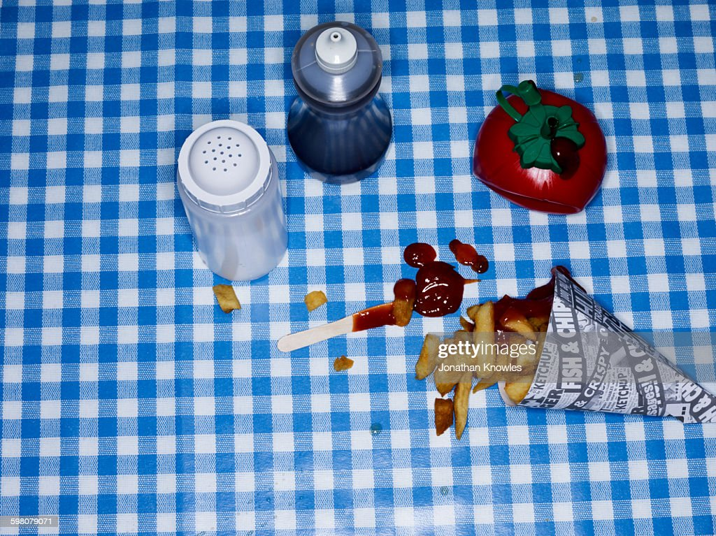 Chips with ketchup on blue check tablecloth : Stock Photo