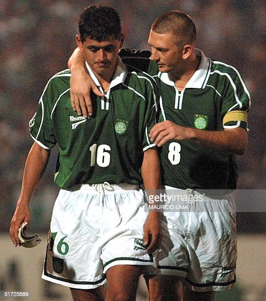Chique Arce of the Palmeiras team is consoled by Palmeiras Galeano after missing a penalty shot during their Libertadores Cup semifinal match against...