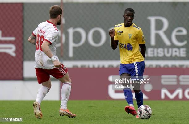 Chiquinho of GD Estoril Praia with Rafael Furlan of UD Vilafranquense in action during the Liga Pro match between GD Estoril Praia and UD...