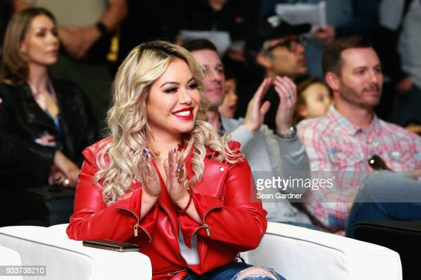 Chiquis Rivera is seen during the driver's meeting prior to the Monster Energy NASCAR Cup Series Auto Club 400 at Auto Club Speedway on March 18 2018...