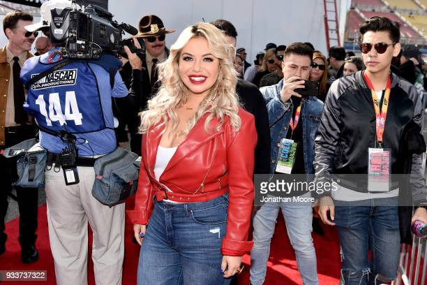 Chiquis Rivera walks the red carpet prior to the Monster Energy NASCAR Cup Series Auto Club 400 at Auto Club Speedway on March 18 2018 in Fontana...