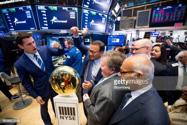 Chirag Patel cofounder and cochairman of Amneal Pharmaceuticals Inc center rings a ceremonial bell during the company's listing on the floor of the...