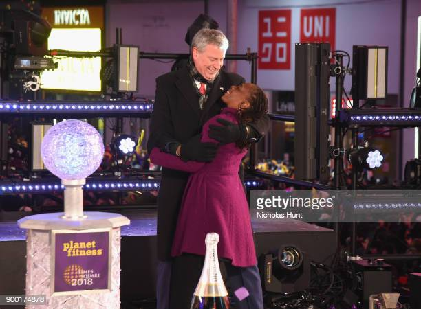 Chirlane McCray and New York City Mayor Bill de Blasio embrace onstage at the Dick Clark's New Year's Rockin' Eve with Ryan Seacrest 2018 on December...