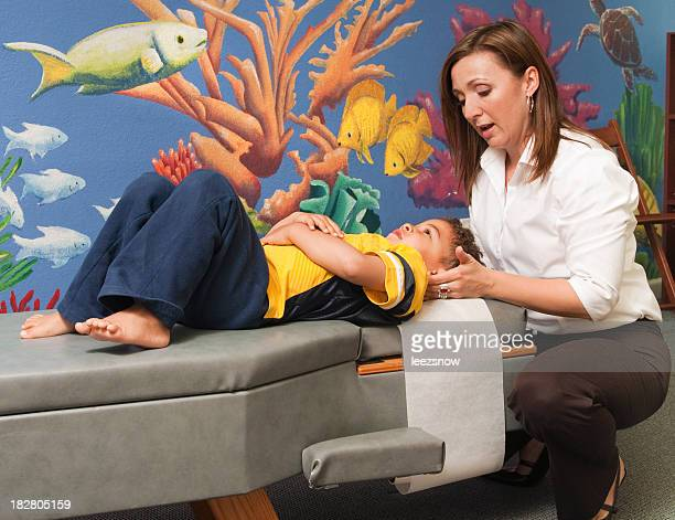 Chiropractor Treating a Child