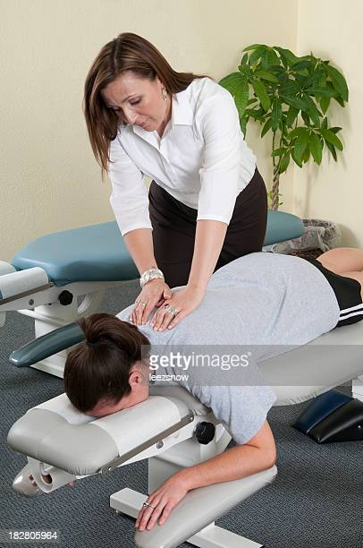 Chiropractor Treating a Patient's Back