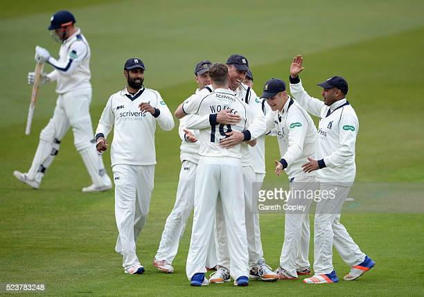 Chirs Woakes of Warwickshire celebrates with teammates after dismissing Jonathan Bairstow of Yorkshire during the Specsavers County Championship...