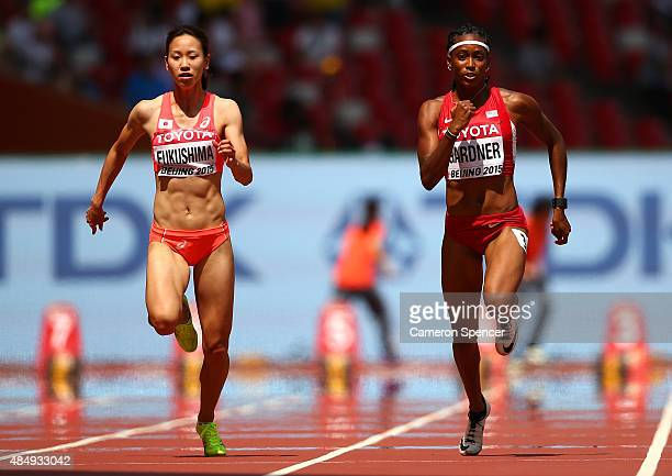 Chisato Fukushima of Japan and English Gardner of the United States compete in the Women's 100 metres heats during day two of the 15th IAAF World...