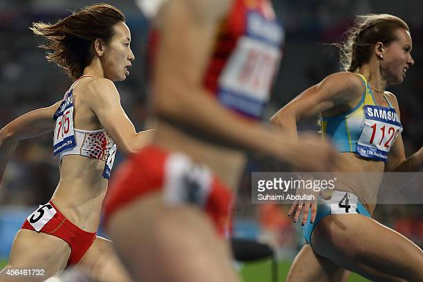 Chisato Fukushima of Japan and Olga Safronova of Kazakhstan compete in the Women's 200m Final on day twelve of the 2014 Asian Games at Incheon Asiad...