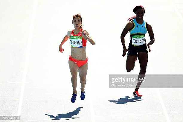 Chisato Fukushima of Japan and Sheniqua Ferguson of the Bahamas compete in round one of the Women's 200m on Day 10 of the Rio 2016 Olympic Games at...