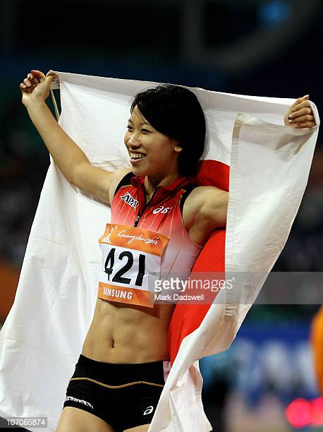 Chisato Fukushima of Japan celebrates after winning the gold medal in the Women's 100m final at Aoti Main Stadium during day ten of the 16th Asian...