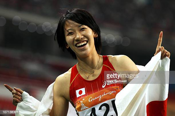 Chisato Fukushima of Japan celebrates after winning the gold medal in the women's 200m final at Aoti Main Stadium during day thirteen of the 16th...
