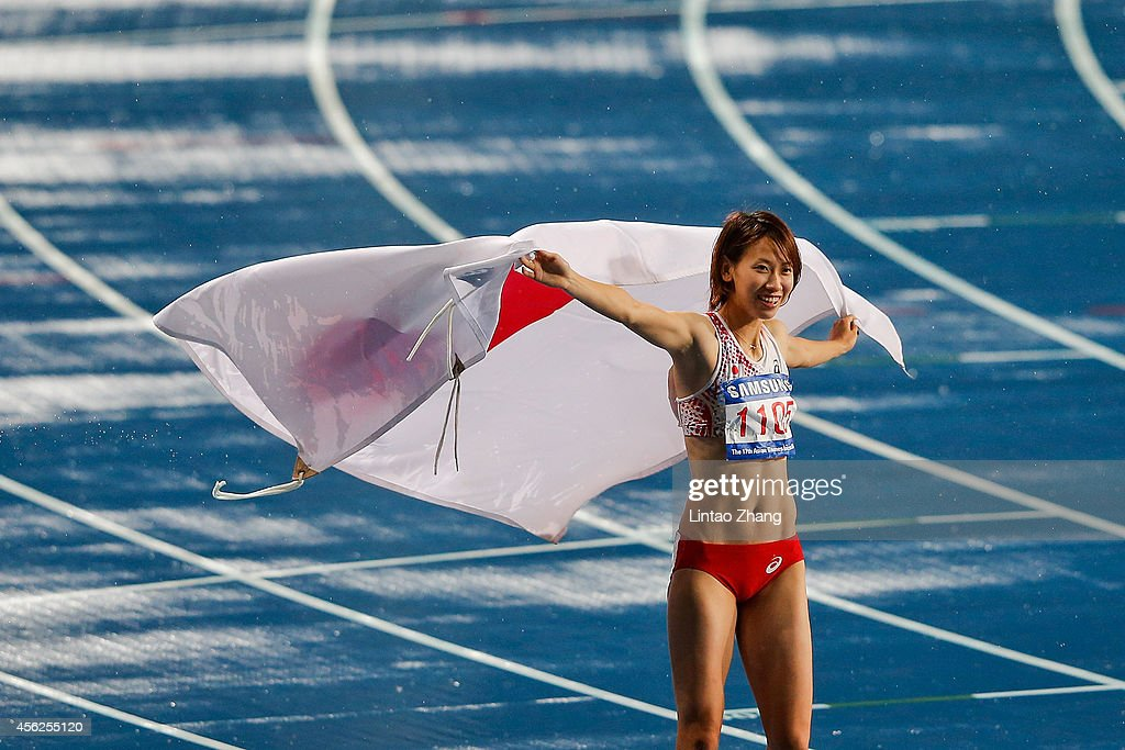 Chisato Fukushima of Japan celebrates winning the silver medal in the Women's 100m Final during day nine of the 2014 Asian Games at Incheon Asiad Main Stadium on September 28, 2014 in Incheon, South Korea.