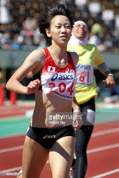 Chisato Fukushima of Japan crosses the finish line to win the gold medal in a time of 2349 in the Women's 200m final during the day four of the 19th...