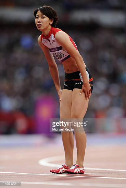 Chisato Fukushima of Japan looks on after she runs in the Women's 200m heat on Day 10 of the London 2012 Olympic Games at the Olympic Stadium on...
