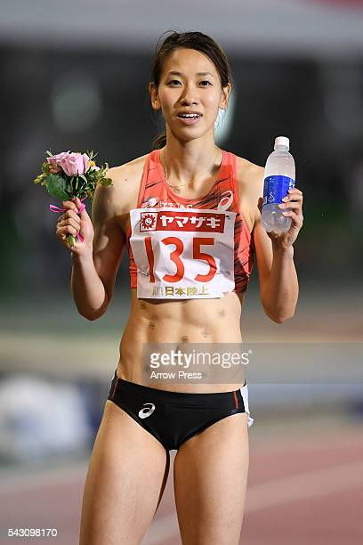 Chisato Fukushima of Japan pose with the after winning the competes in Women's 100m Final during the 100th Japan National Athletic Championships at...
