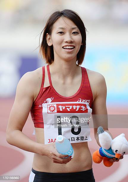 Chisato Fukushima of Japan smiles for camera after the Women's 100m sprint on day two of the 97th Japan Track and Field Championships at Ajinomoto...