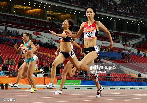 Chisato Fukushima of Japan wins the women's 200m final at Aoti Main Stadium during day thirteen of the 16th Asian Games Guangzhou 2010 on November...