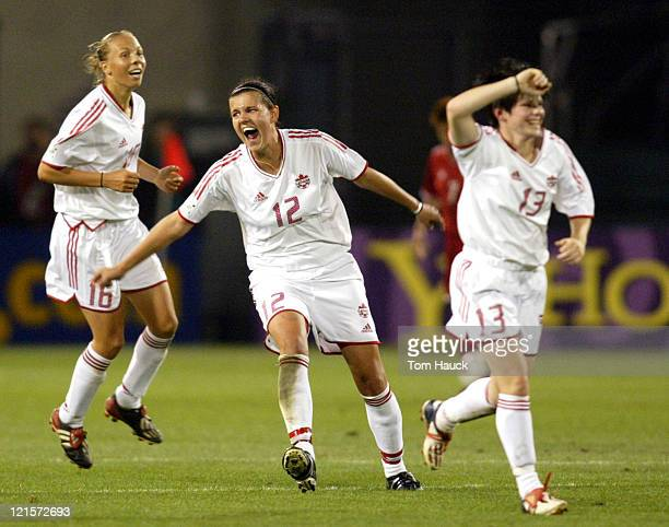Chistine Sinclair of Canada celebrates Canada's victory with teammates after pulling off a 10 win over Chinain The 2003 Women's World Cup...