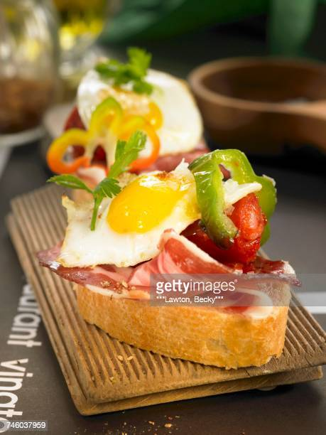 Chistorra and fried quails egg open sandwich