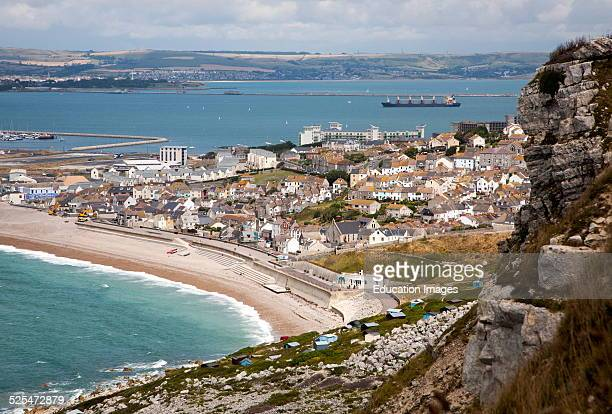Chiswell village at the start of Chesil Beach with Weymouth harbor beyond Isle of Portland Dorset England