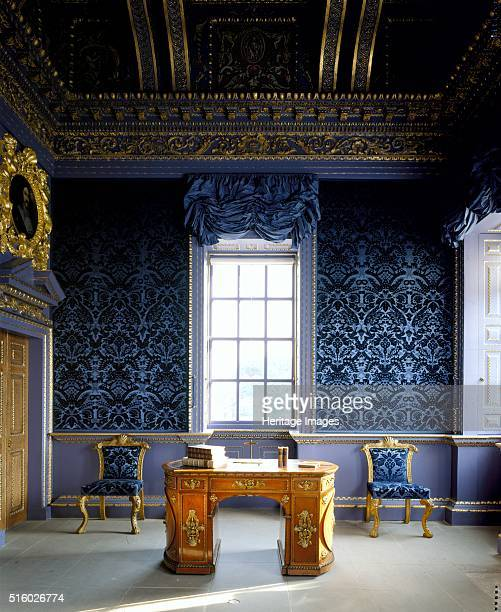Chiswick House London c2000s The Blue Velvet Room showing a library table with rounded ends and two tapestry chairs Chiswick House is a Palladian...