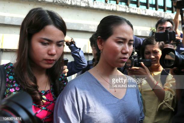 Chit Su Win and Panei Mon wife of jailed Myanmar journalists Kyaw Soe Oo and Wa Lone leave the Yangon Regional High Court in Yangon on January 11,...
