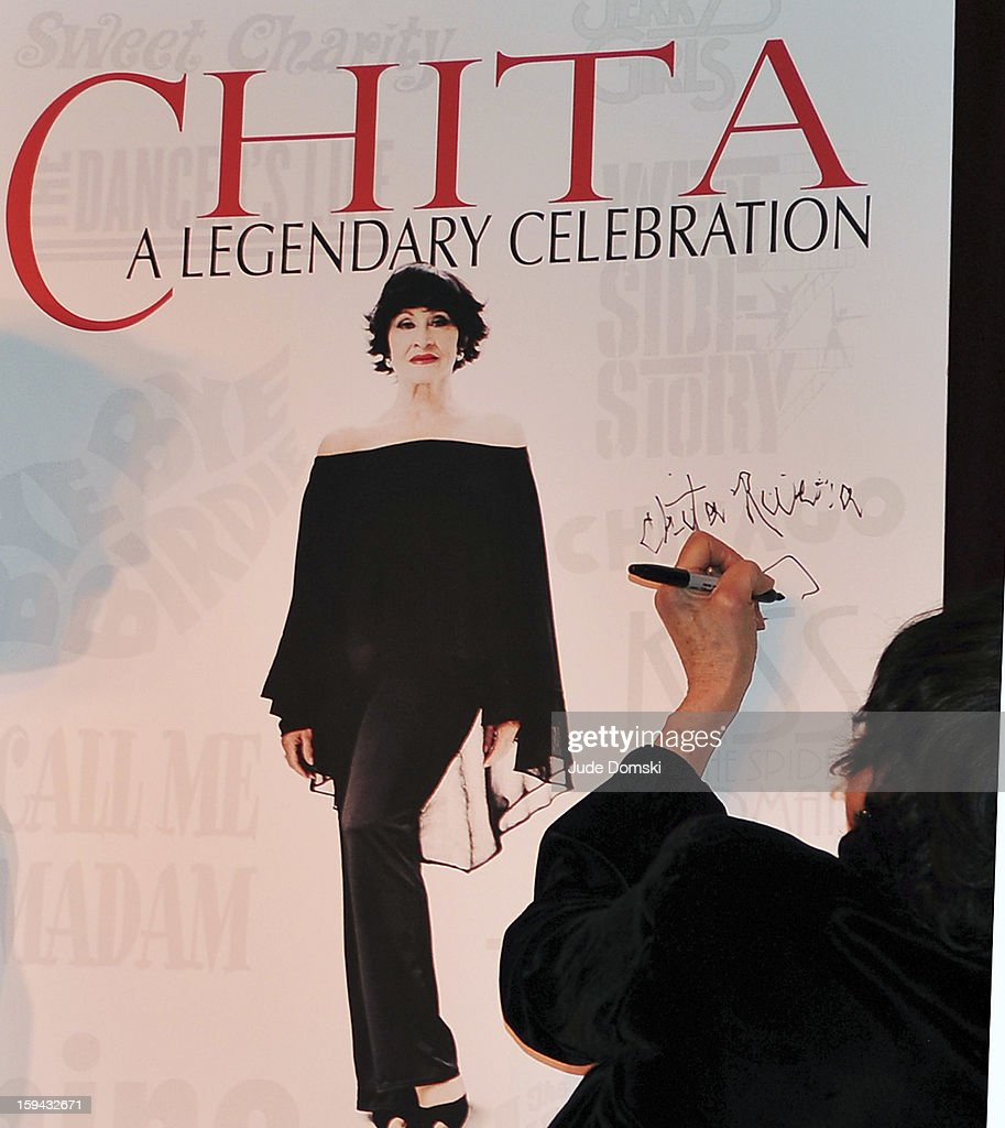 Chita Rivera signing a poster at Press Conference at Birdland Jazz Club on January 13, 2013 in New York City.