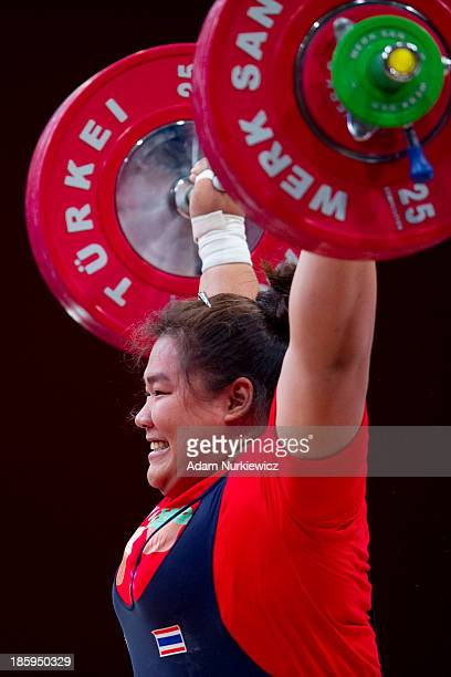 Chitchnok Pulsabsakul from Thailand lifts in the Snatch competition women's 75 kg Group A during weightlifting IWF World Championships Wroclaw 2013...