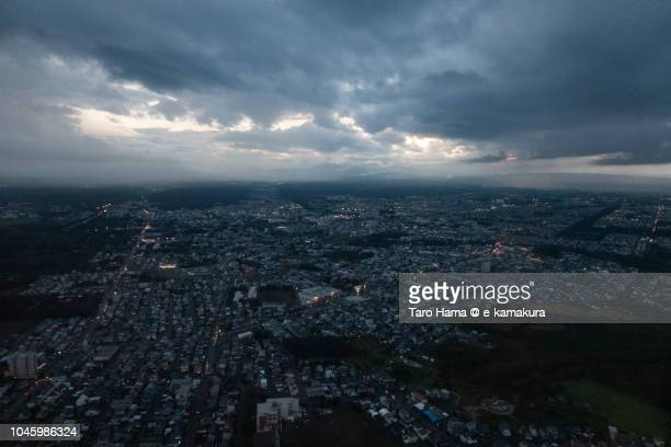 Chitose city in Hokkaido in Japan sunset time aerial view from airplane