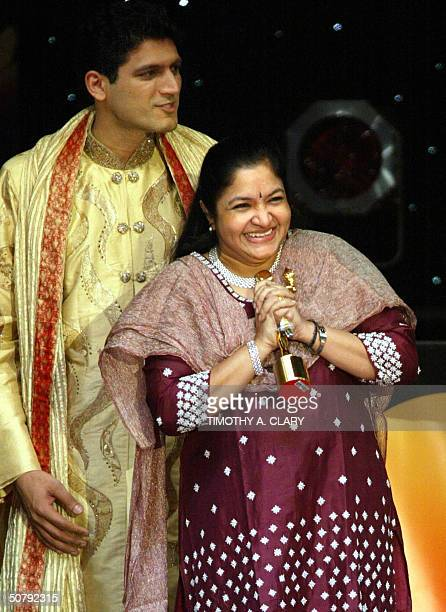 Chitra accepts her award for Best Female Singer during the 2004 Bollywood Movie Awards at the Trump Taj Mahal 01 May 2004 in Atlantic City New Jersey...