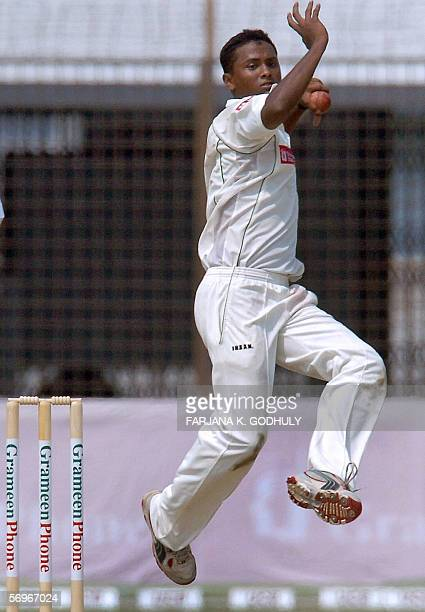 Bangladeshi spinner leaps in the air as he delivers the ball to Sri Lankan batsman Kumar Sangakkara during the second day of the first Test match...