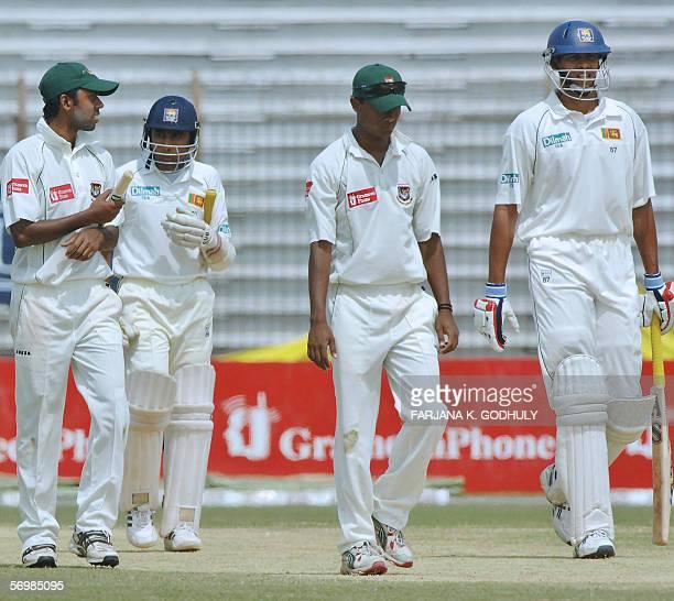 Sri Lanka cricket captain Mahela Jayawardene and teammate Michael Vandort walk off the pitch with Bangladeshi fielders after Sri Lankan won the first...