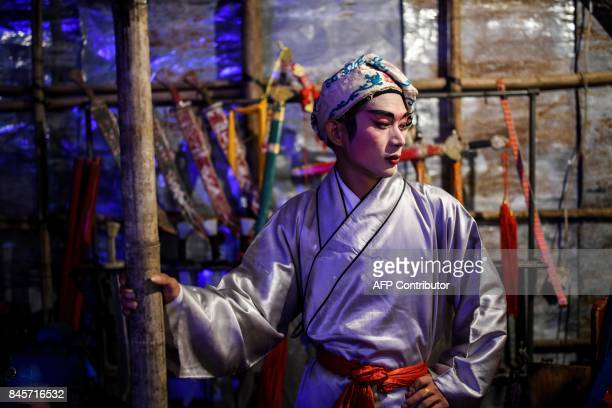 Chiu Chow opera actor prepares for a performance during an event to mark the Hungry Ghost Festival in Hong Kong on September 11, 2017. The festival,...