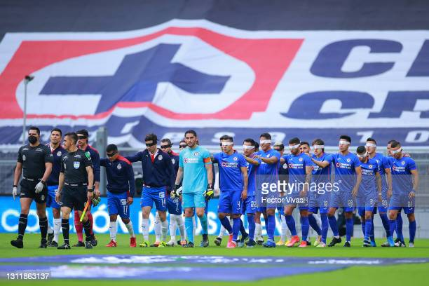 Chivas and Cruz Azul players go out to the playing field blindfolded to raise awareness of people who suffer from visual impairment prior the 14th...