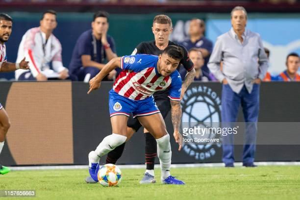 Chivas de Guadalajara forrward Alexis Vega and Atletico de Madrid defender Kieran Trippier battle for the ball during the International Champions Cup...