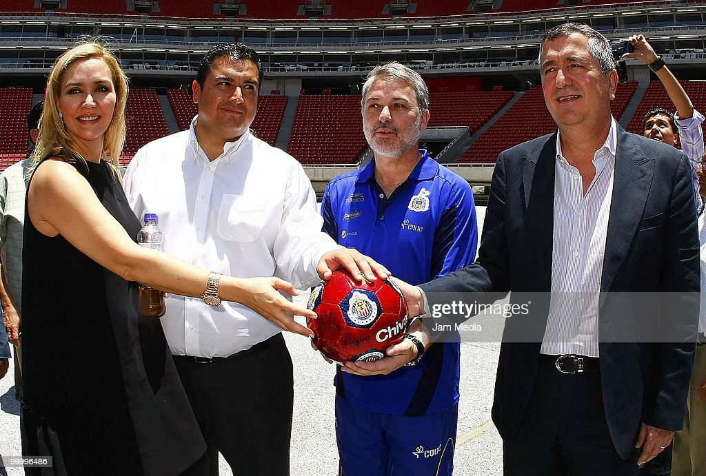 Chivas' Director Angelica Fuentes (L), Chivas' president Jorge Vergara (C) and Governor of Jalisco Emilio Gonzalez (R) pose for a photograph during a visit to the construction of new Chivas Guadalajara stadium on May 19, 2010 in Guadalajara, Mexico.
