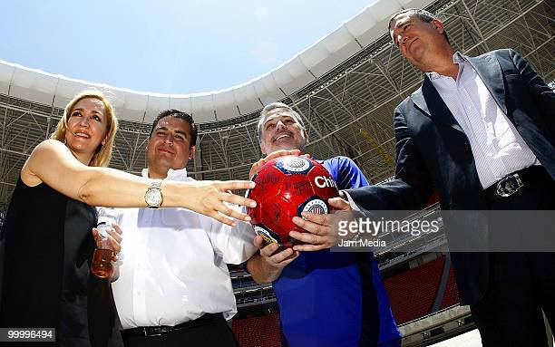 Chivas' Director Angelica Fuentes Chivas' president Jorge Vergara and Governor of Jalisco Emilio Gonzalez pose for a photograph during a visit to the...