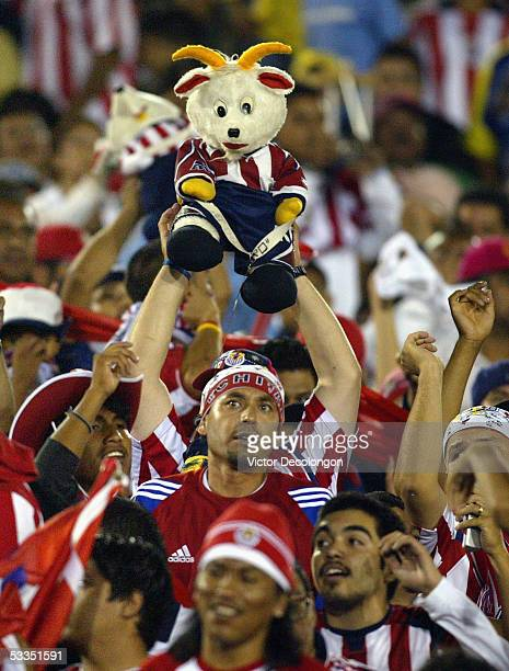 Chivas fans hold up the Chivas mascot during the friendly match between Chivas de Guadalajara and Club America of the Mexican professional soccer...