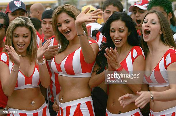 Chivas girls have fun with the fans on prior to the game against the Los Angeles Galaxy on April 23 2005 at the Home Depot Center in Carson...