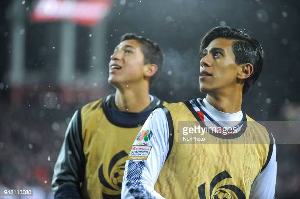 CD Chivas Guadalajara players are looking at the core board during the 2018 CONCACAF Champions League Final match between Toronto FC and CD Chivas...