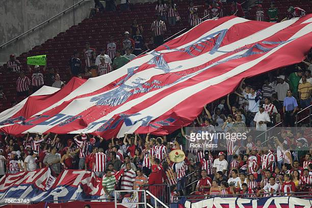 Chivas of Guadalajara fans wave a huge banner during a match between FC Dallas and Chivas of Guadalajara July 24 2007 in Frisco Texas