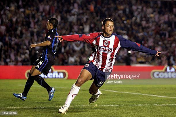 Chivas' player Javier Hernandez celebrates his scoared goal against Queretaro during their match as part of the 2010 Bicentenary Tournament in the...