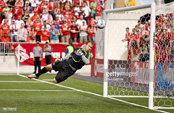 Chivas USA keeper Brad Guzan makes a diving save during the match between Chivas USA and Toronto FC at BMO Field in Toronto, Canada on August 18,...