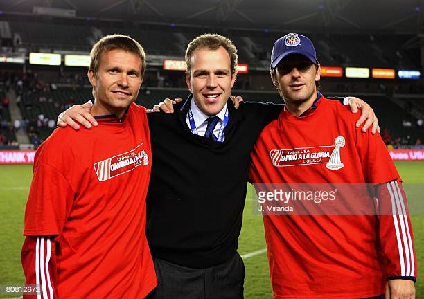 Chivas USA's Jesse Marsch and Ante Razov celebarte with team coowner Antonio Cue after taking the regular season Western Conference title following a...