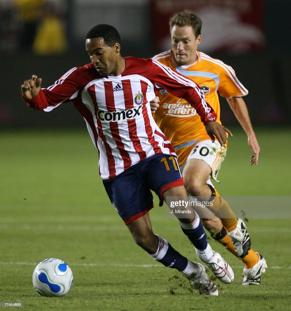 Chivas USA's Maykel Galindo in action against Houston Dynamo's Richard Mulrooney. Chivas wins the regular season Western Conference title following a scoreless draw with Dynamo at The Home Depot Center on October 20, 2007 in Carson.