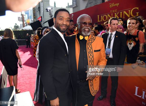 """Chiwetel Ejiofor and John Kani attend the premiere of Disney's """"The Lion King"""" at Dolby Theatre on July 09, 2019 in Hollywood, California."""